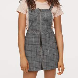 black and white dress overalls with clip button straps and a zip down the middle. worn only a few times so basically new condition