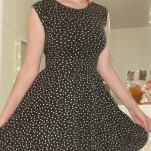 I am selling a black dress with white polka dots. perfect condition, and the dress will be washed and ironed before sale;)