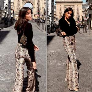 Zara long snake print trousers. Very comfortable! Waist band. It can easily fit S / M sizes. Popular blogger trousers! Sold out! Excellent condition. Size S  Please check out my other items! :)