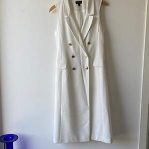 Topshop white longline sleeveless double breasted blazer dress. Can be worn as long waistcoats over jeans & shorts. Size 36. Perfect condition, never worn.
