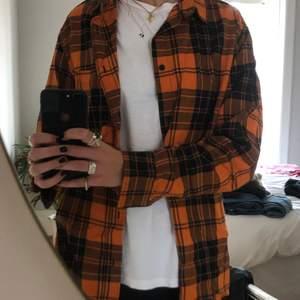Orange rutig skjorta från H&M använda fåtal gånger.
