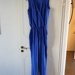Brand new blue jumpsuit. Size 36, but can also work for 38.