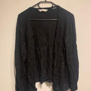 Long armed black cardigan with very soft and cozy material, from Target Australia, worn but in good condition.
