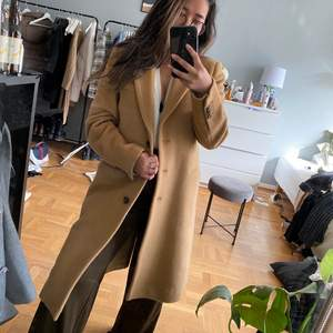 Beige wool coat from Tiger of Sweden. Have only used once and selling it because it is a little big for me. Size 36