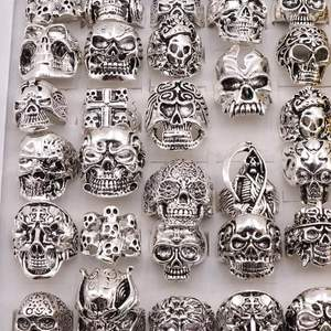Silver skull rings in different sizes.