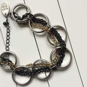 Armband från glitter. Nypris 150 Silver guld och svart.