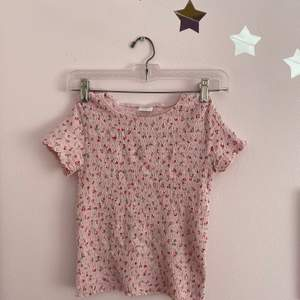 This top is a very aesthetic cute baby pink stretchy top. It is an XS but I'm a S and it fits me well. If you are interested contact me. This top works supper well with shorts, jeans, or even a black skirt.