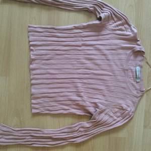 Light pink knitwear