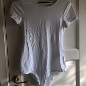Basic T-shirt body från lager 157. Aldrig använd