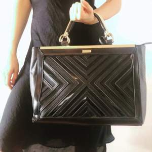 Black bag with golden details