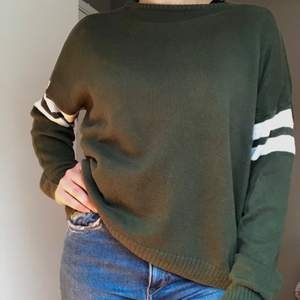 BRAND NEW Brandy Melville Sweater. One Size (I am a size S). Green and White. Never Worn. Bought for 45 US Dollars.