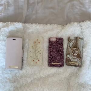 Jag säljer fyra skal till iphone6+/7+/8+. Tre av skalen är från iDeal of Sweden (plånboksfodralet, marmorerade skalet och det rosa leopardskalet) och det andra från H&M. 2 av skalen har defekter där skalen gått sönder (bild) men det påverkar ej användningen. Säljer även tillhörande mobilring. Skicka meddelande för mer information. H&M skalet säljs för 10 kr och ideal of sweden skalen runt 50 kr/st.
