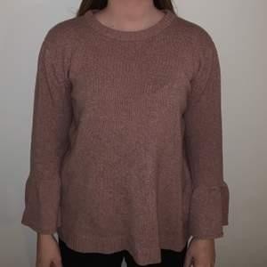 Stickad tröja med vida ärmar, rosa/mauve. S