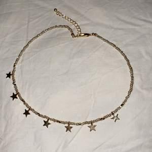 Tight halsband med stjärnor. Aldrig använt.