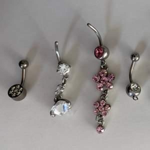 Piercingsmycken till naveln. Smyckena på första bilden är av kirurgiskt stål (förutom den första som är ett läkessmycke i äkta titan). Smyckena på andra bilden är i äkta silver. Ett smycke för 30 kr eller alla för 170 kr. Bjuder på frakten.