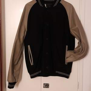 Baseboll style man jacket with leather arms. Semi new condition.