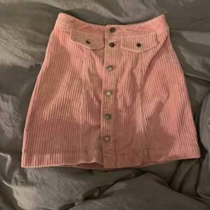 Rosa Manchester kjol