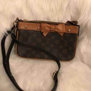 Fake Louis Vuitton handväska