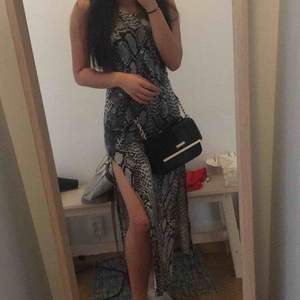 Snakeskin maxi dress with slits