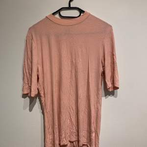Size large, very stretchy and soft material with mid length sleeves and high collar. Bought second hand but never worn.