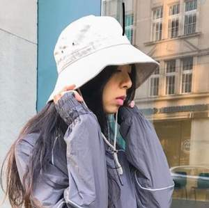 Beige bucket hat with draw string. Contact for more details