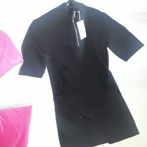 En Carin Wester klänning som alldri g är använd,  ord pris  399 kr.