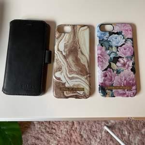 säljer två av mina ideal of sweden skal och även ett magnetisk plånboksfodral också från ideal of sweden som passar iphone 6/7/8,, 40kr/st eller alla för 100kr, superbra skick! inga repor eller skador ❗️skalet i mitten är sålt ❗️