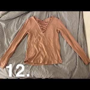 Vanlig basic rosa tröja med snörning sparsamt använd, köparen står för ev frakt