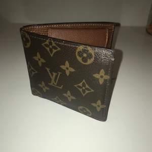 Plånbok från Louis Vuitton (fejk). Se storleks format på bild 3.