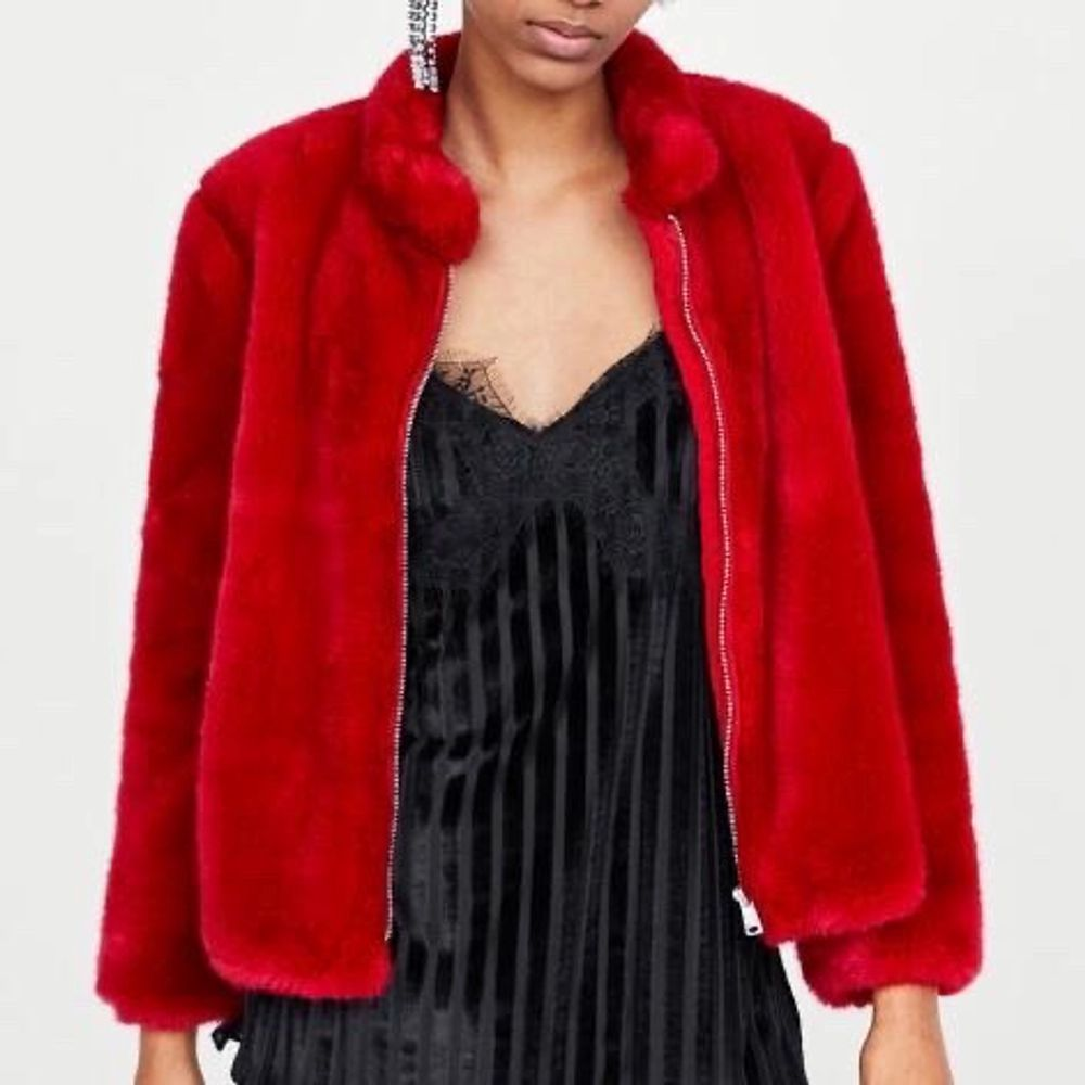 Super cute and sassy scarlet fluffy jacket perfect to throw on over anything, perfect condition. Has pockets. Great for evenings! Has never been woren. . Jackor.