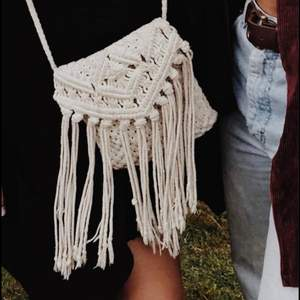Beautiful crochet purse handmade in Bali! It has a long shoulder strap and a zip to hold everything in. Great condition!
