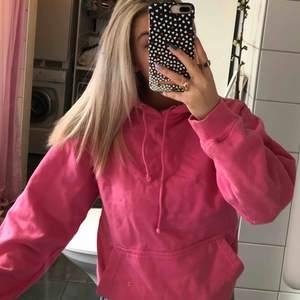 Rosa hoodie med coolt tryck från UF företaget Le Futur!