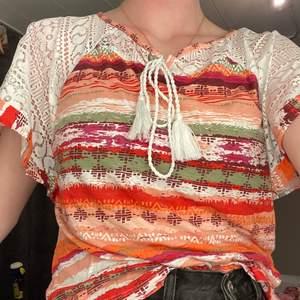 Cool T-shirt från rainbow stl 40/42 - medium. Bra skick nästan aldrig använd