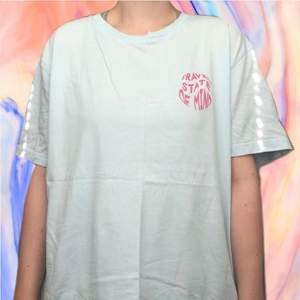 Baby blue slogan T-shirt with 'travel state of mind' on chest. Men's size M