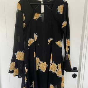 Floral dress from bikbok! very cute and the skirt comes out in an A line shape.