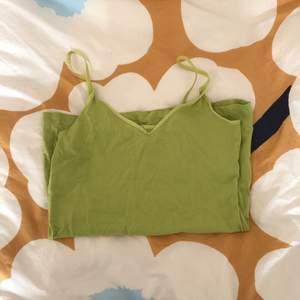 Grön/gult bomulls linne. Aldrig använt, men supersnyggt!