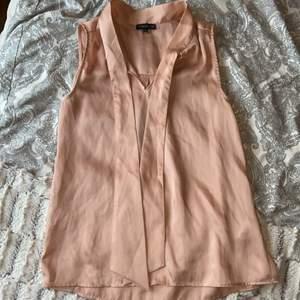 Rosa linne från Stockh LM i storlek XS med knyte