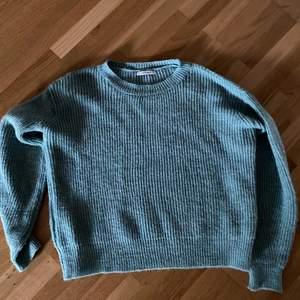 grön/blå stickad tröja från Chiquelle