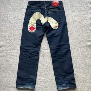 Evisu Jeans, Size 38, leg opening: 25cm, inner leg: 87cm lenght: 117cm waist: 100cm