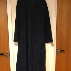 Used black dress, can be worn as a cardigan when buttons opened