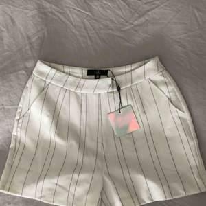 Säljer dessa oanvända shorts i storlek 38 från Missguided.