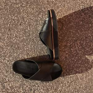 Black sandals from Samsoe Samsoe in leather and suede. They are worn maybe twice indoors. The sole is thick and easy to walk with. Selling these because they are too big., I'm a size 38.
