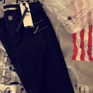 NYA jeans från