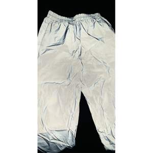 Reflective pants that glow in the dark.  Goes to the ankle and can fits a 34 / xs and 36 / s.  Nothing wrong.  Used once.