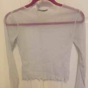 Fin silverglittrig genomskinlig tröja från Brandy Melville