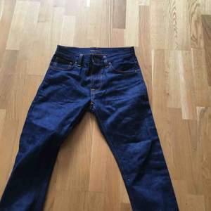 Helt oanvända nudie jeans i storlek 28.