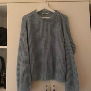 Stickad tröja från Gina Tricot.