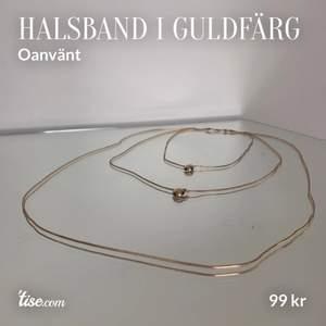Halsband i guldfärg med tre längder. Den kortaste kedjan är 48 cm. Ej äkta guld. Frakt: 12 kr. Skriv vid frågor eller för fler bilder :)