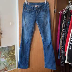lowrise bootcut jeans. worn condition, thinned denim in some places.