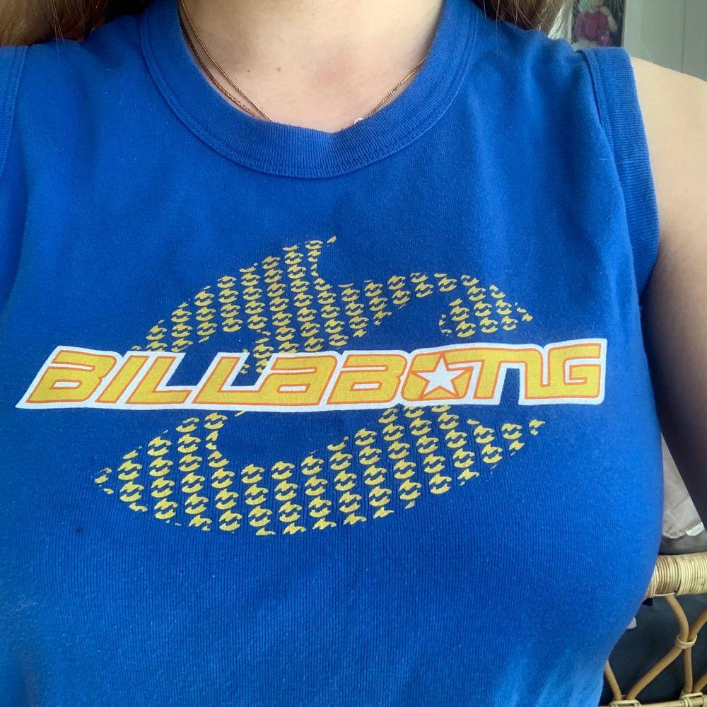 blått gult linne från Billabong, passar en xs eller S. Toppar.